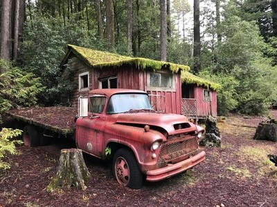 Vintage logging truck and cabin in northern California