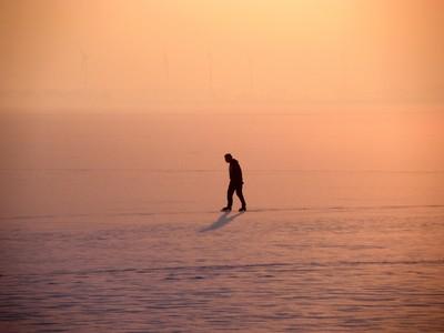 walking on ice in sunset light (Holland)