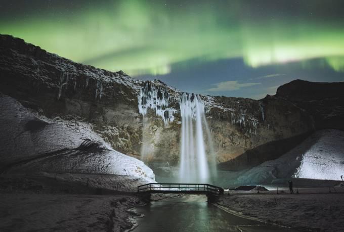 Dancing lights above one of many icelandic waterfalls. Instagram.com/mattb_st by mattbenham - Night Wonders Photo Contest