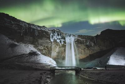 Dancing lights above one of many icelandic waterfalls. Instagram.com-mattb_st