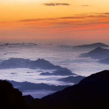 This scene was the reward for getting up early on a ridge top of the Huangshan Mountains, China. These mountains are famous for their steep granite ridges and their cloud formations, including under casts that hug the ground around the bases of the mountains.