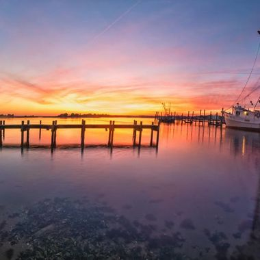 Pretty decent sunset in my home town of Swansboro North Carolina.  This was my first attempt at creating a HDR panorama.  I think it turned it pretty decent.