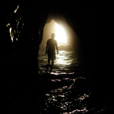 When the tide is out, it is possible to explore the caves at Playa Ventanas, as the waves come rolling in.
