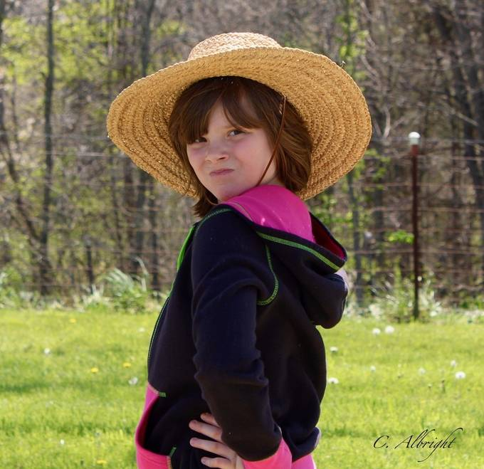 A spirited young lady emerges when she puts on the right hat!