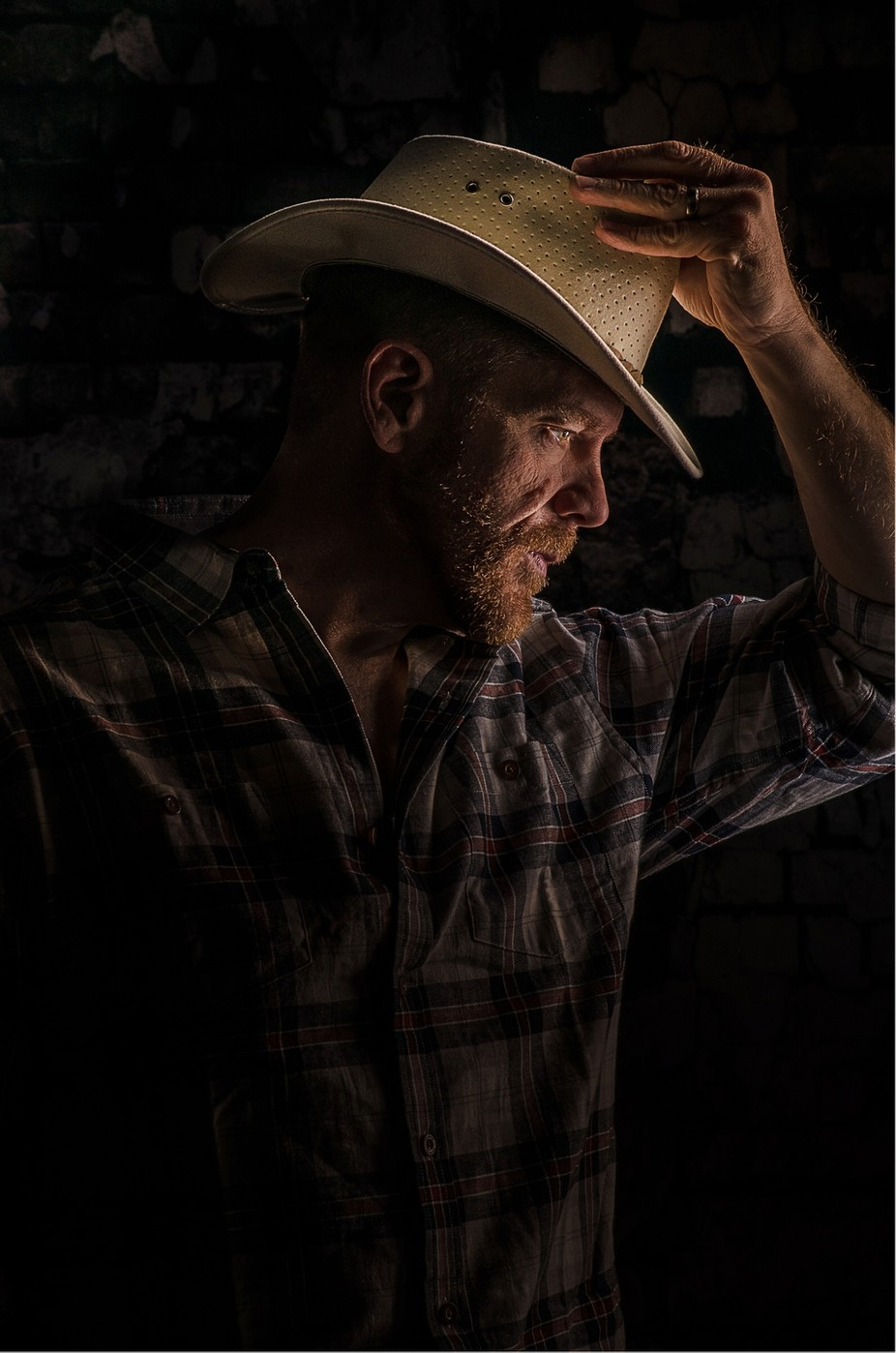 One of my favorite photos of my handsome fiancé. Practicing with lighting in our basement. by Daneane - Male Portraits Photo Contest