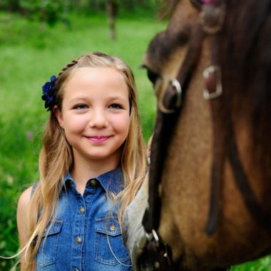 My pretty little girl muse meets Maverick, a roguishly handsome horse, in a meadow of Sweet Peas amongst the Oak Trees.