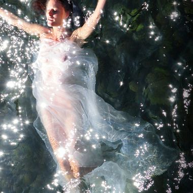 Echo looks truly angelic and ethereal as she floats in the river.  This photo has not been manipulated at all.