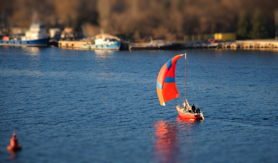 A small sailing yacht passing channel