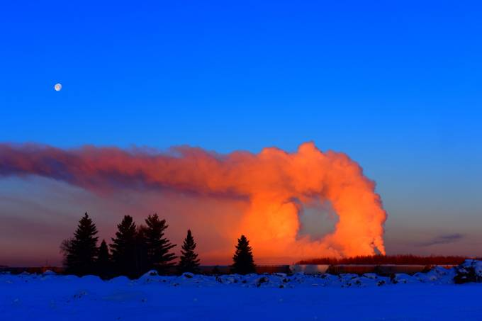The early morning smoke rising over PCA made an interesting portal to Canada or ????. Facing North from Int'l Falls, Minnesota. Shot supervivid Nikon D3400