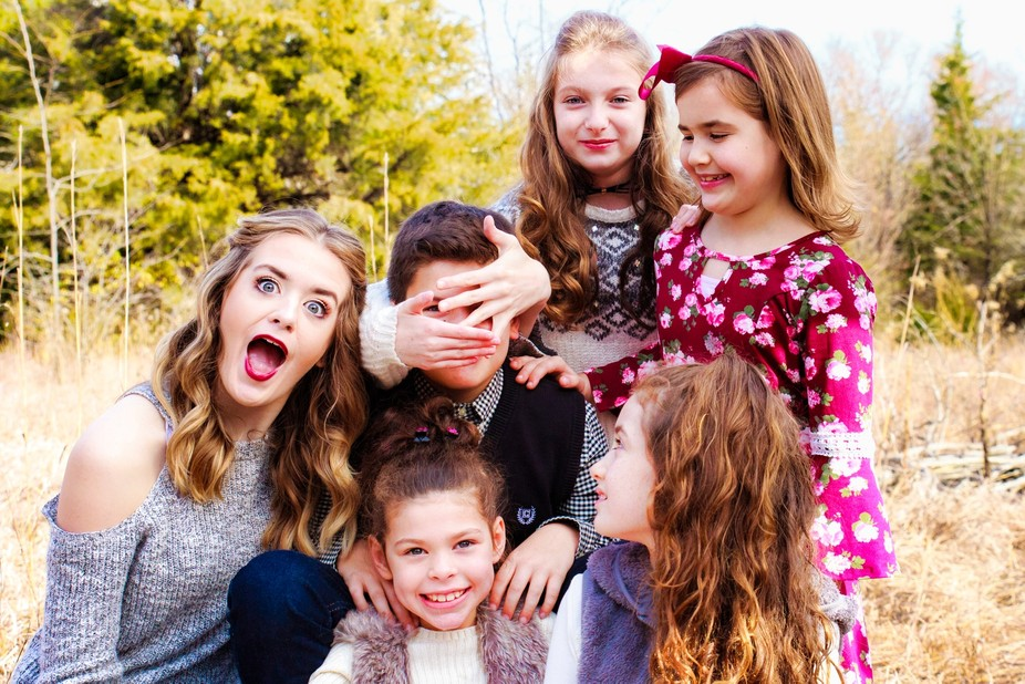 This family of kiddos wanted to do a less serious photo.  The boy in the middle was a bit overwhe...