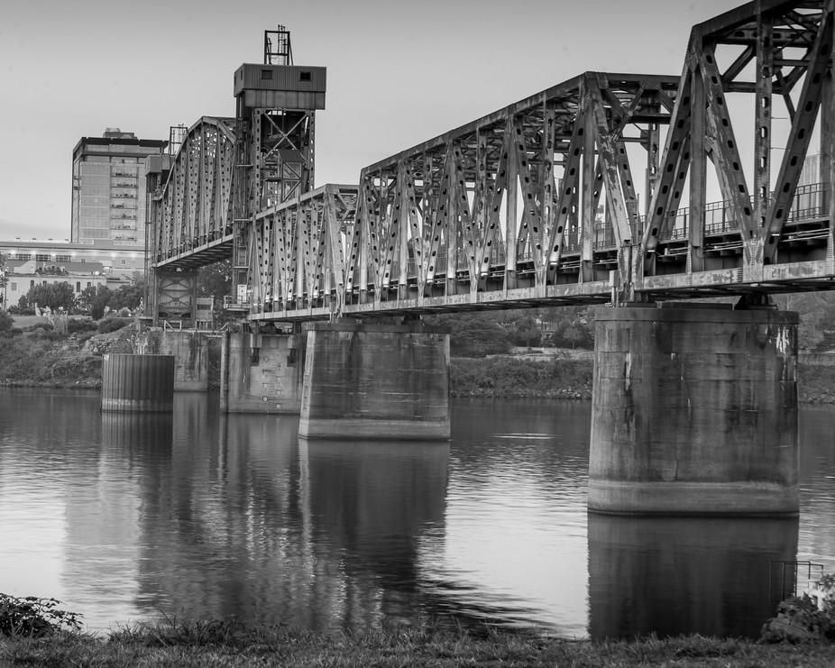 Old railroad bridge turned into a pedestrian bridge crossing the Arkansas River in Little Rock Ar...