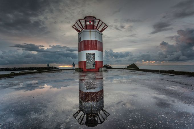 Reflection of a lighthouse by tarakiers - Architecture And Reflections Photo Contest