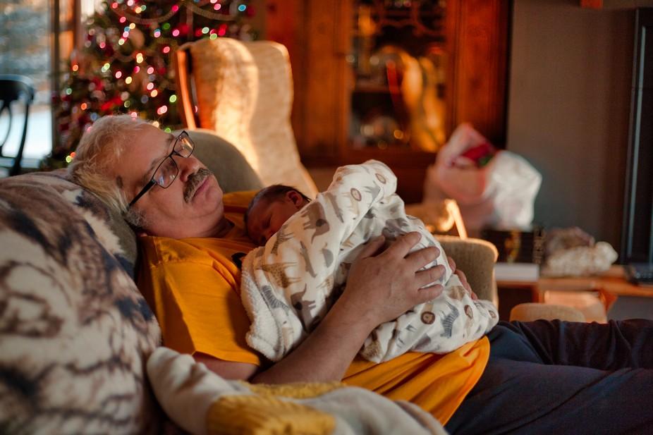 Granddaughter and grandpa share a Christmas nap.