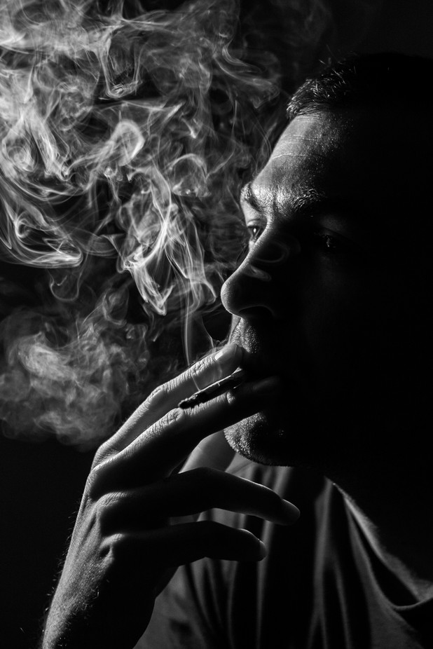 Smoking in the dark by MarkoBeljan - Monochrome Creative Compositions Photo Contest