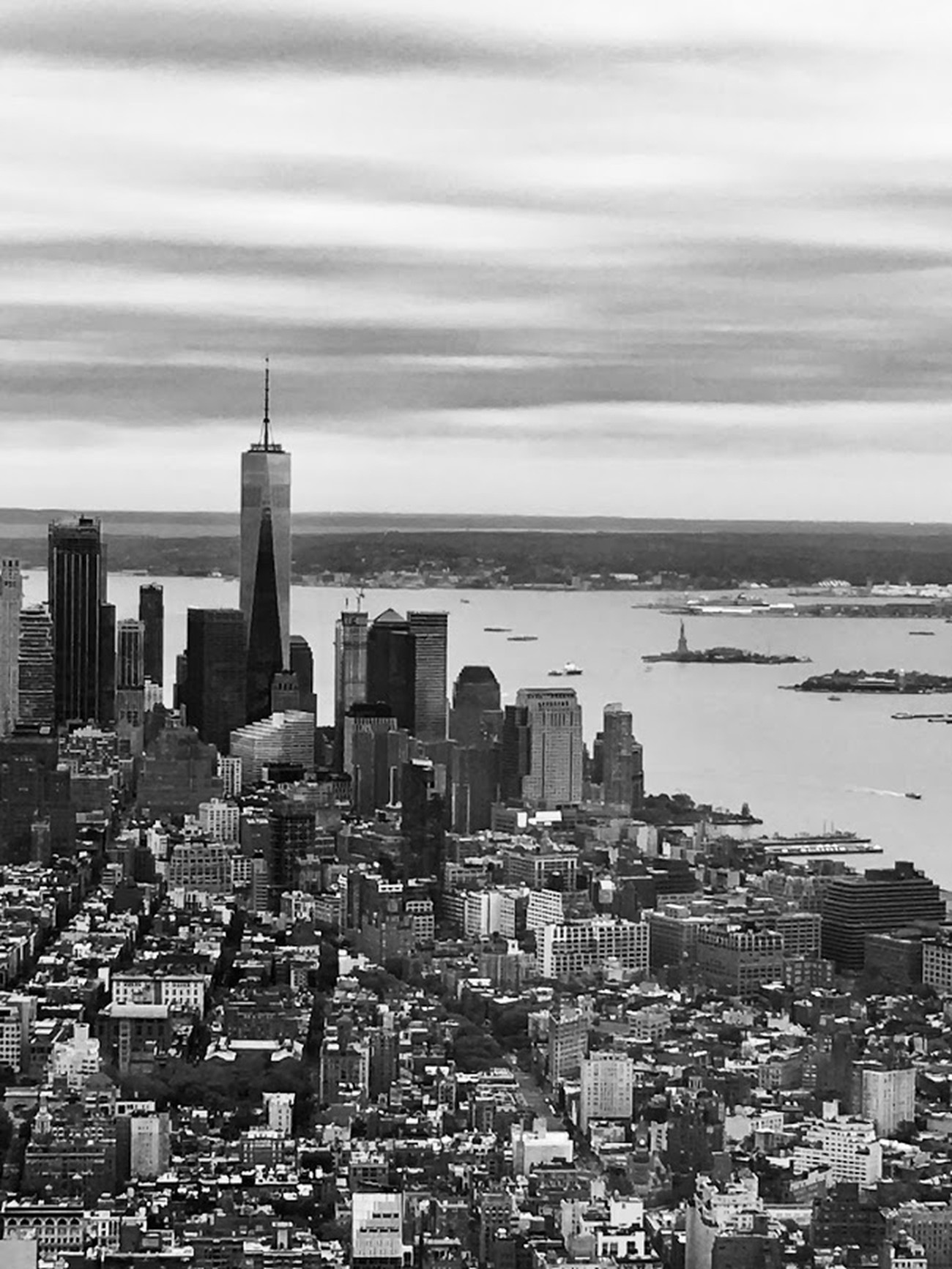My first trip to New York was last year in April, my birthday being September 11th, this was definitely for me, a Moody photo.  The humble but proud symbol, our Statue of Liberty has a clear view of Manhattan and the new One World Trade Center.