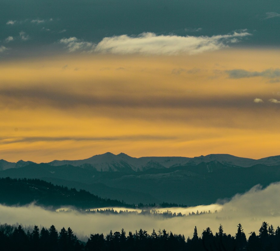 The image was taken from Seattle looking southeast towards the Cascade Mountains. Specifically, t...
