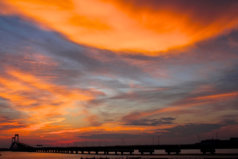 A beautiful movement of clouds over our Newport bridge during the sunset hours.  Silhouettes, bei...