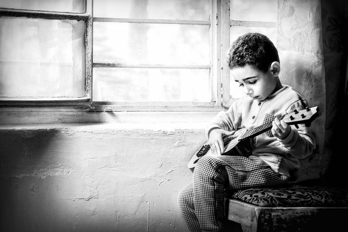 Little Guitar Player by saadalhamady - Music And Concerts Photo Contest