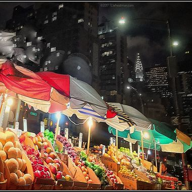 This well stocked street vendor and the Chrysler Building in the background deserved to be shot.