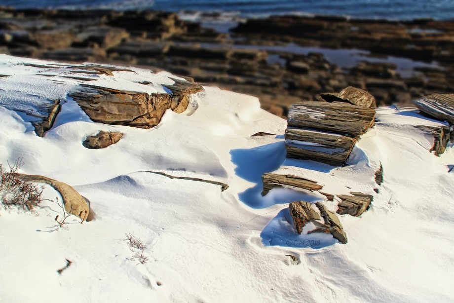 Shot of some jagged rocks covered in snow. I made a mistake thinking this stuff was hard but was ...