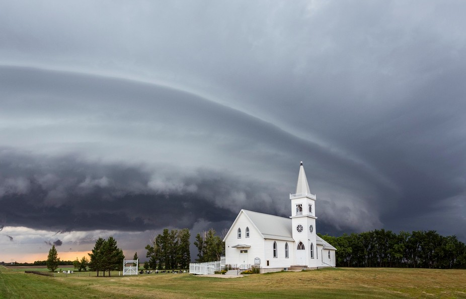A supercell menaces a local mennonite church near Saskatoon, Saskatchewan, Canada this summer. Th...