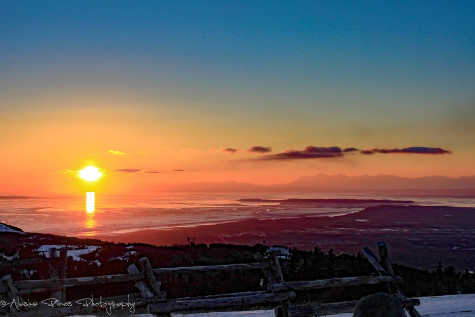 Setting sun over Anchorage, from Flattop viewing point in the Chugach mountains.