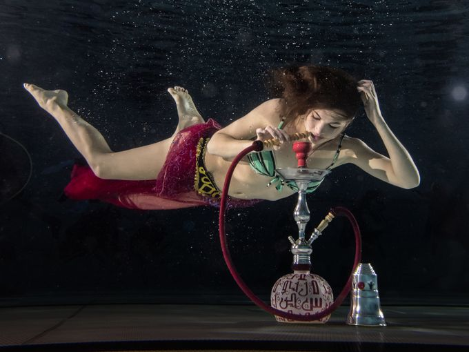 Shot underwater using three strobes and a waterpipe / shisha.  Model: Emma Jeannette (Model Mayhem No. 3128341).  20150418 129 underwater Emma Jeannet