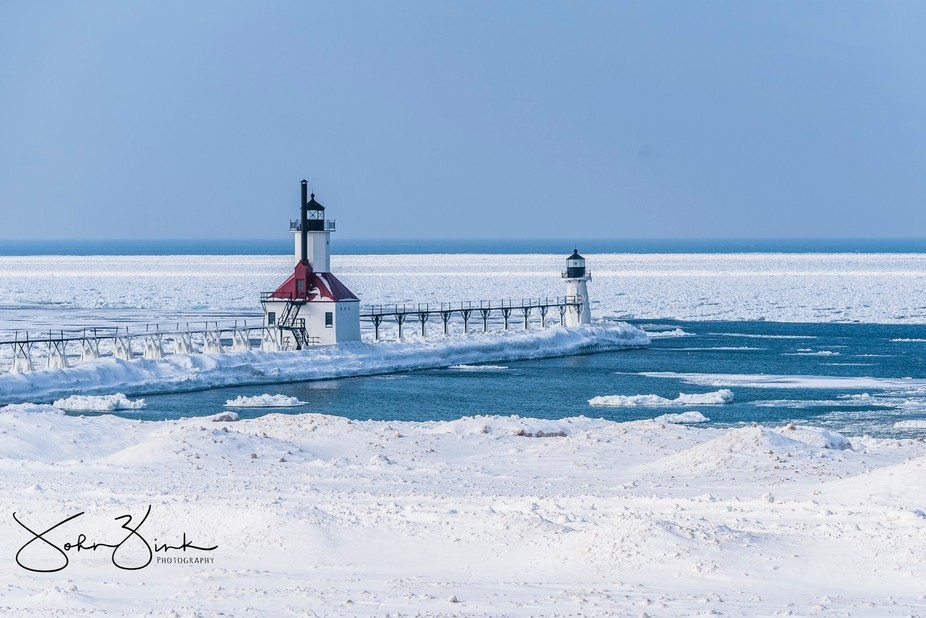 Bracketed HDR shot from Saint Joseph, Mi onto of a bluff overlooking the frozen lighthouses in Ja...
