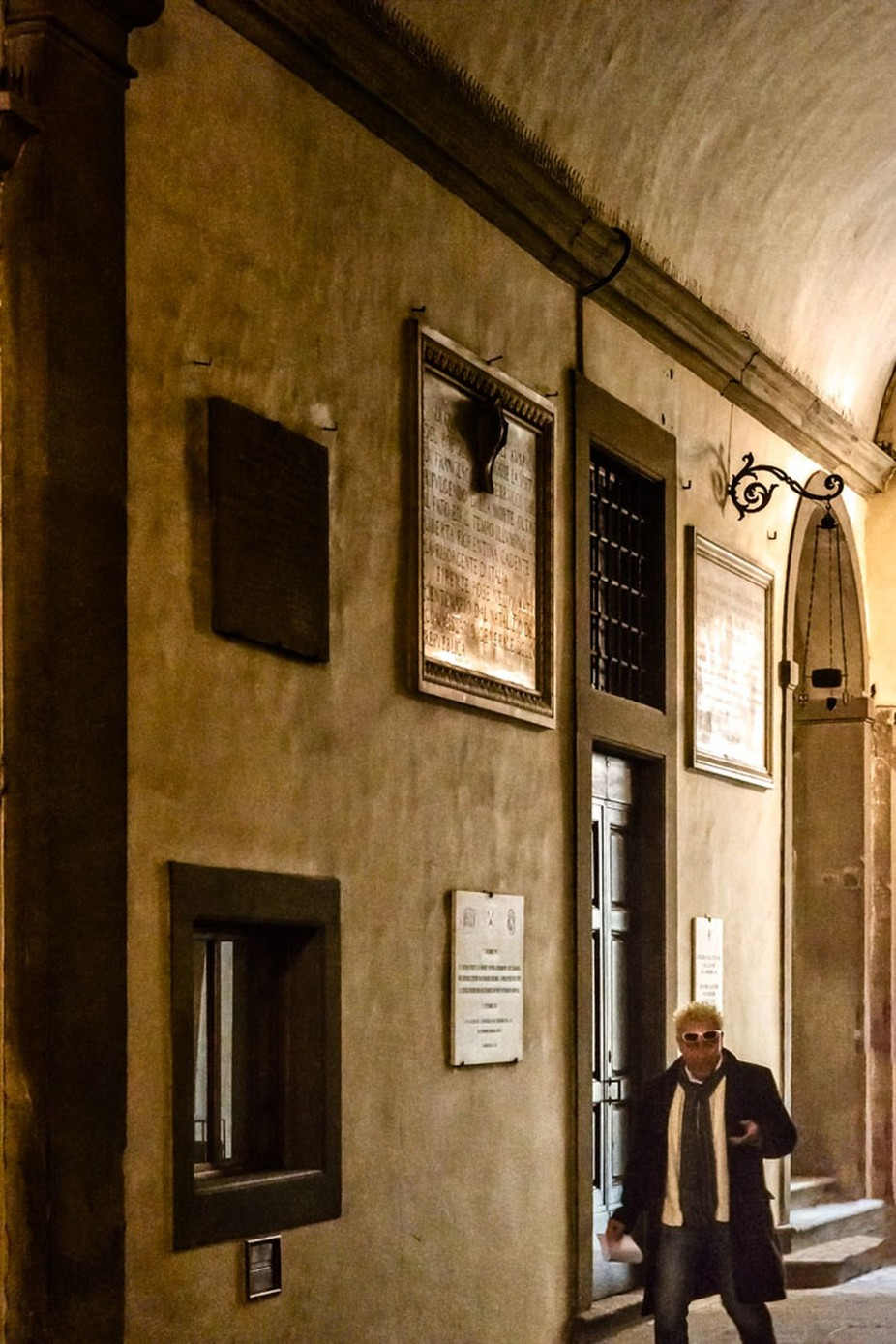 In the Palazzo Vecchio, even in this environment and in this light only looking at the screen of his smartphone, in Florence, Italy