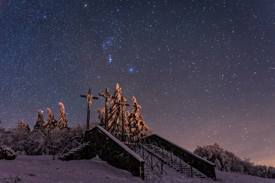 A cold winter night in the Rhoen, a Bawarian highland. In the sky the Orion constellation is shin...