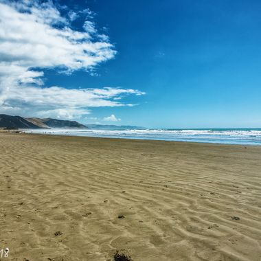A large beach, almost to ourselves! Christmas day, New Zealand.
