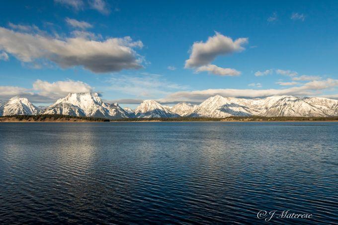 Jackson Lake Under The Snowcapped Grand Tetons