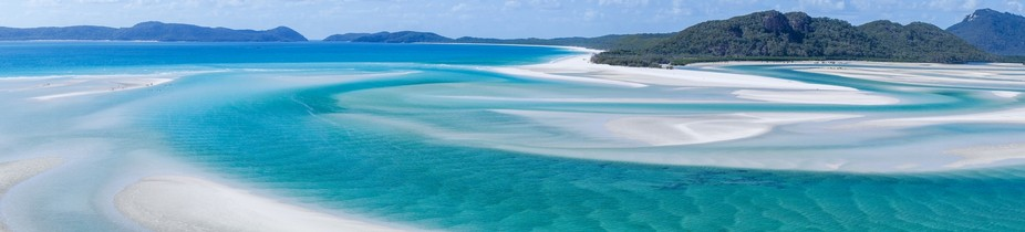 Panoramic shot of the Whitsundays, Whitehaven Beach. This is considered the whitest sand on earth.