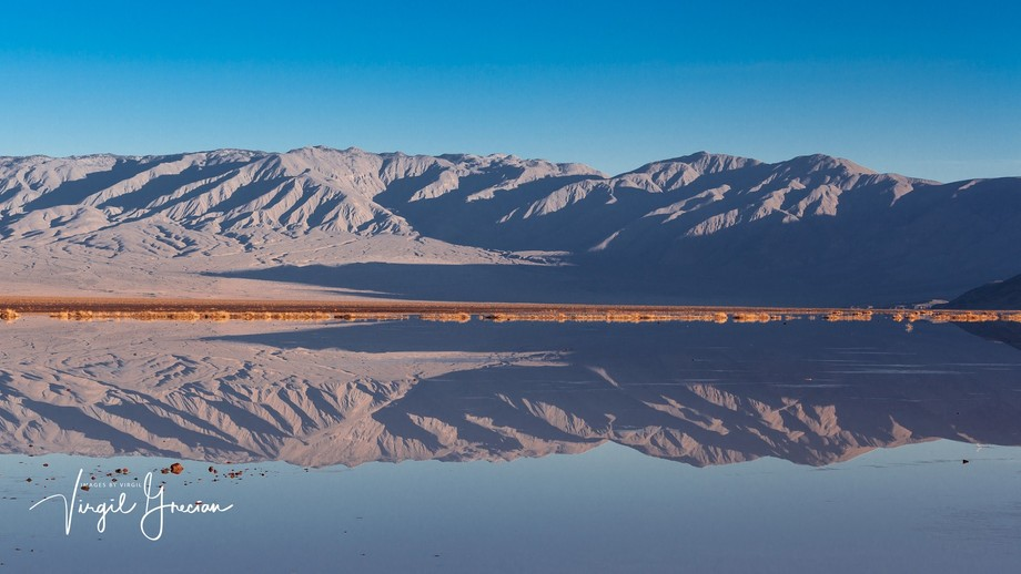Panorama of early morning reflection on the desert lake.