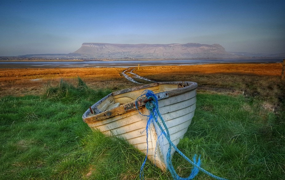 Brought ashore for winter months a boat on lower rossespoint beach under benbulben the great tabl...