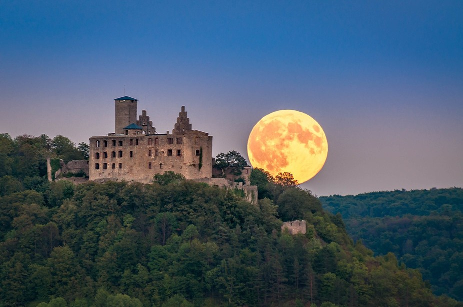 The supermoon over the ruins of the castle Trimburg in Franconia.