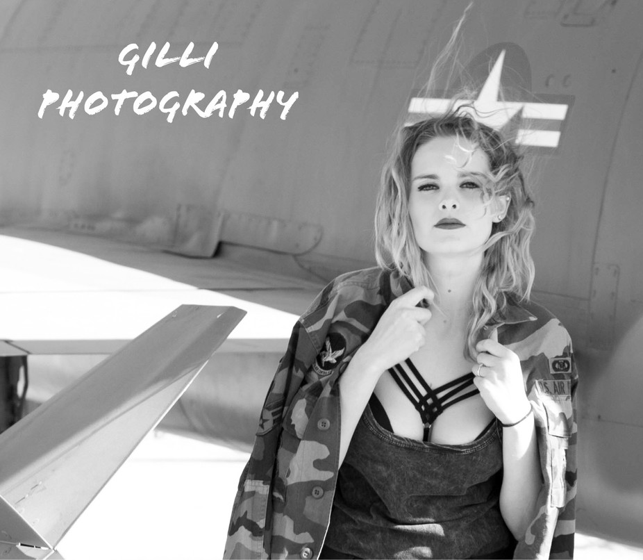 Photograph of Kaila Stone with one of the jets at Davis-Monthan AFB AZ