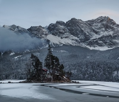 Frozen Alpine Lake sunset