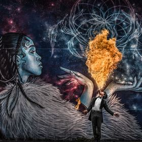 Firebreather Andrey Das in front of a street art picture of FKA Twigs