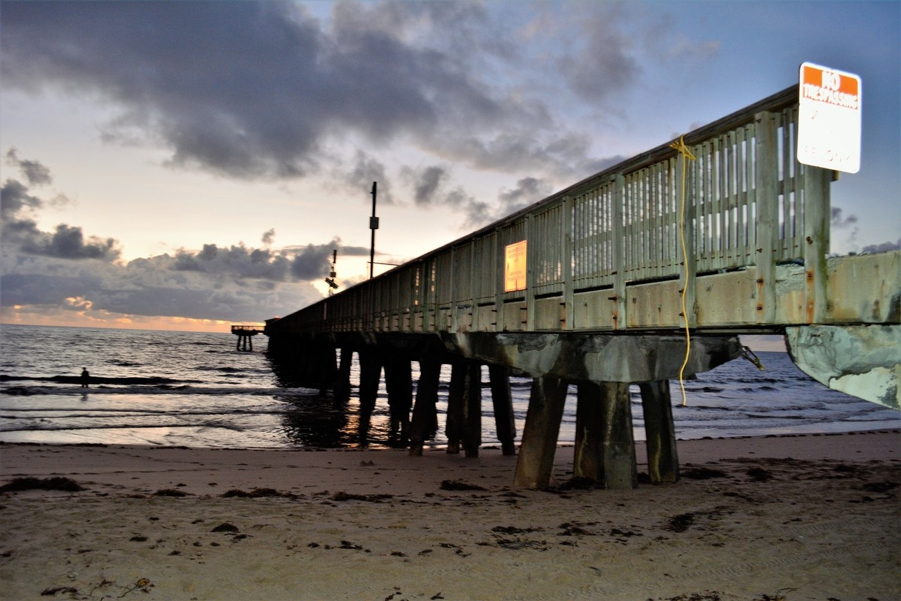 Into the waters was taken at Pompano Beach Pier, and this was a few weeks after hurricane Irma, towards the end of the sand the pier is separated from where it begins. Partially destroyed but is under restoration. I hope they can restore it soon or at least by Spring.