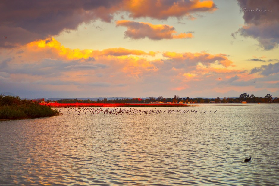 It almost reminds me of a Deep Purple song title; but this fiery colour is on the water, and orange is in the sky. Taken at Lake Wendouree, Ballarat, Australia.   K1SB0887