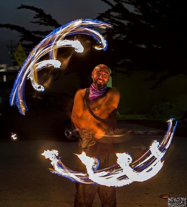 Artist performing in the streets is my take on the contest and caught here spinning torches.my approach was to capture object movement with a slow ahudder speed yet capture focus in the face of the performer.   An exercise of patience, timing and using my