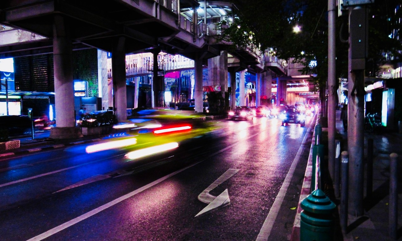 Sukhumvit Road, the traffic swarms just after dark, lifting the streets and sidewalks