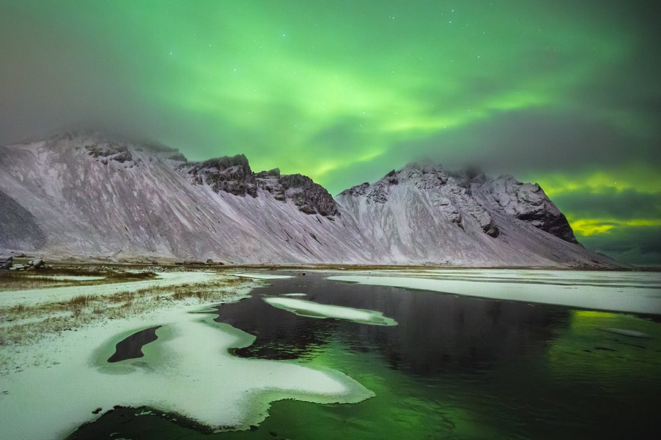 Northern Lights over the mountains at Stokksnes, Höfn, Iceland