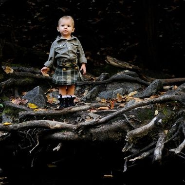 A toddler explores a dark and mysterious forest.