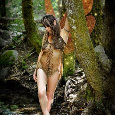 Susan the Forest Fairy wades in Lithia Creek, enjoying the cool shade in the summer.