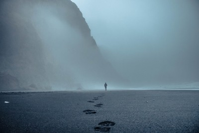 walk on foggy beach
