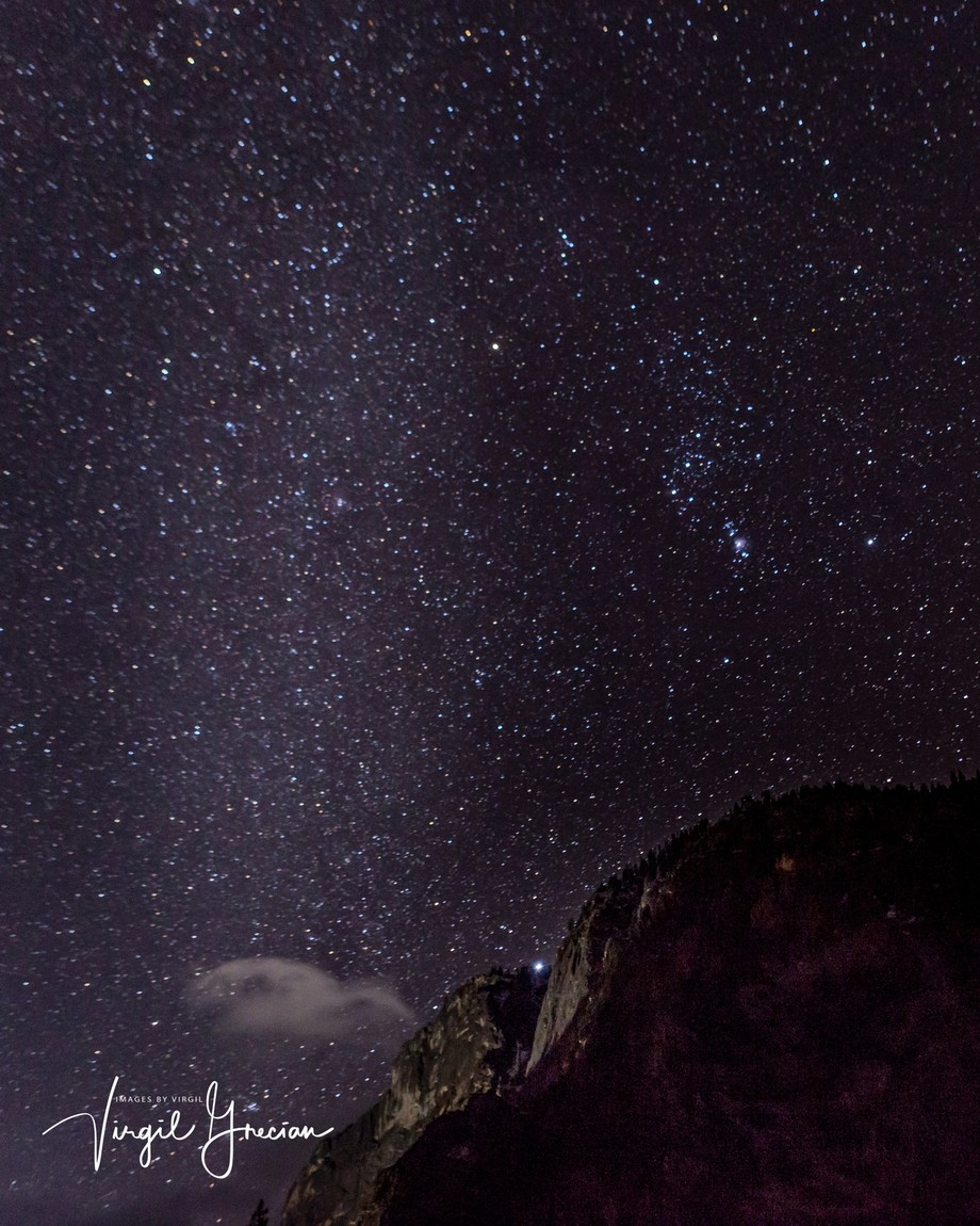 light from the Milky Way cannot hide the night hunter, Orion, in the night sky, above Glacier Point.