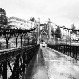 I was walking on that bridge in a rainy day were it was almost empty, only me, my friend and the rain. This is a suspended old bridge in Constant...