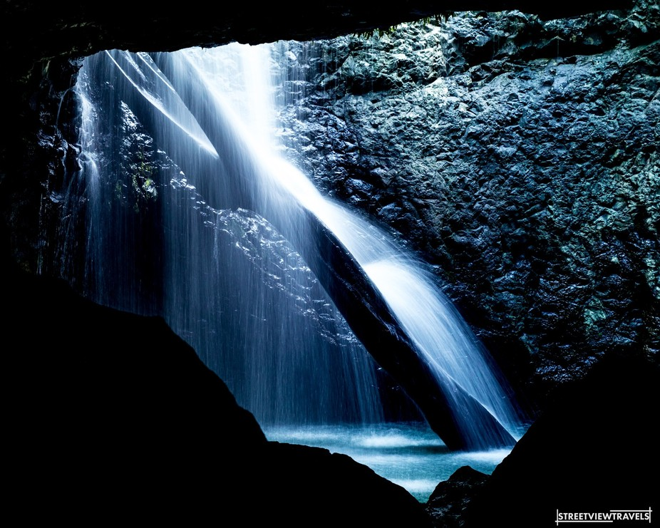 Watching the water cascade down a fallen log in a natural cave surrounded by glow worms. It was p...